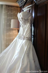 white strapless wedding dress hanging